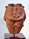 AN ANCIENT EGYPTIAN TERRACOTTA DOUBLE UNGUENTARIUM