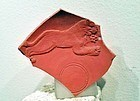 AN ANCIENT ROMAN REDWARE PLATE FRAGMENT