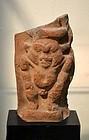AN ANCIENT EGYPTIAN TERRACOTTA BES