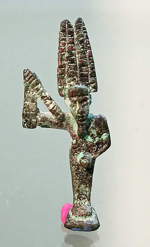 AN ANCIENT EGYPTIAN BRONZE AMULET OF MIN