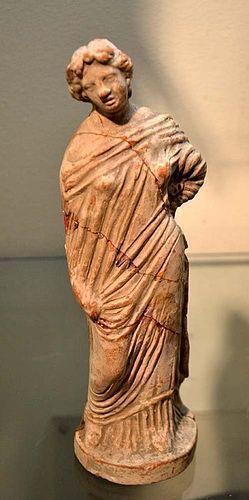 AN ANCIENT GREEK TERRACOTTA FEMALE FIGURE