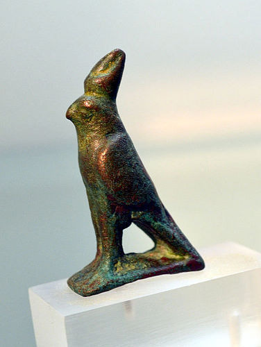 AN ANCIENT EGYPTIAN BRONZE FALCON