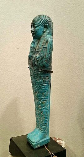 AN EGYPTIAN FAIENCE SHABTI FOR ANKH-EM-MAAT, EX. SOTHEBYS