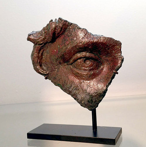 AN ANCIENT ROMAN BRONZE FRAGMENT