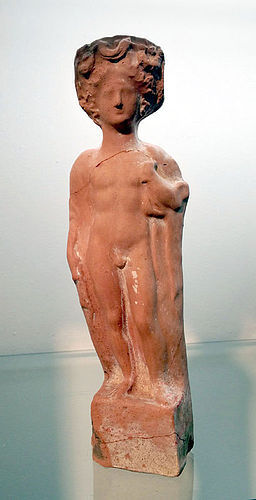A LARGE GREEK TERRACOTTA MALE FIGURE