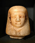 AN ANCIENT EGYPTIAN ALABASTER CANOPIC STOPPER