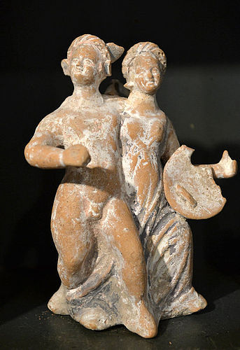 AN ANCIENT GREEK TERRACOTTA FIGURE OF  EROS AND PSYCHE