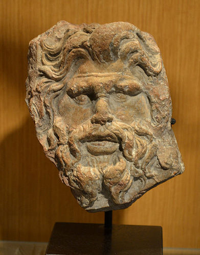 AN ANCIENT GREEK TERRACOTTA HEAD OF MARSYAS