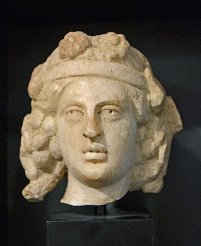 AN ANCIENT ROMAN MARBLE HEAD OF DIONYSUS