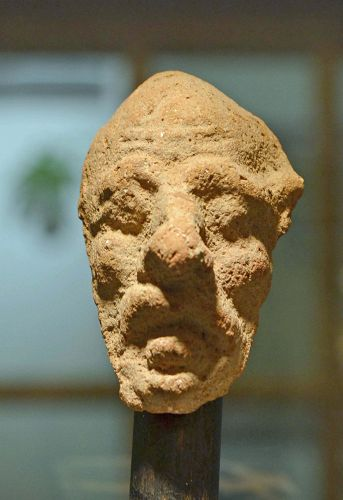 AN ANCIENT GREEK TERRACOTTA HEAD OF A GROTESQUE