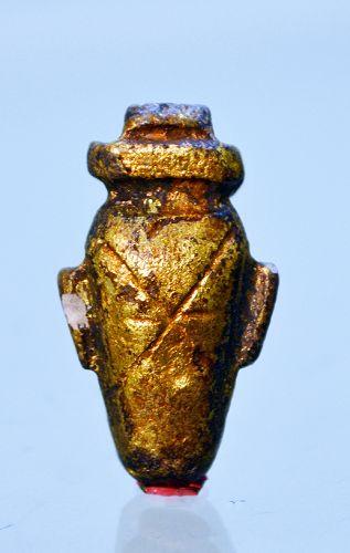 AN ANCIENT EGYPTIAN GILT WOOD HEART
