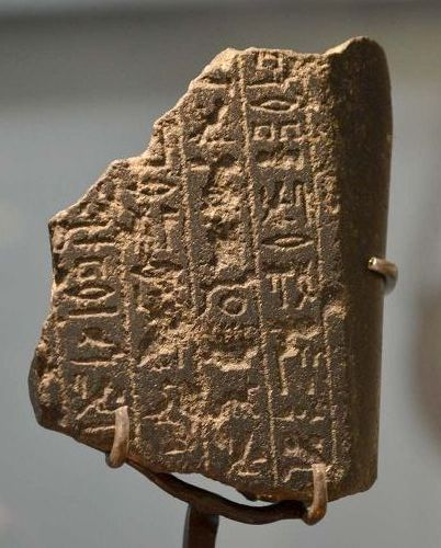 AN ANCIENT EGYPTIAN INSCRIBED BASALT FRAGMENT