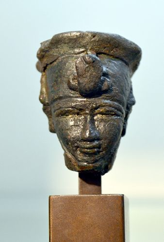 AN ANCIENT EGYPIAN BRONZE HEAD OF AMUN-RA