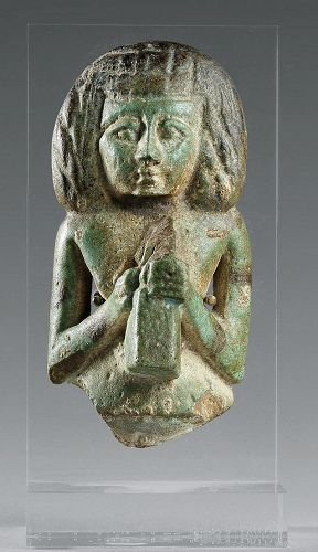 AN ANCIENT EGYPTIAN FAIENCE FEMALE FIGURE