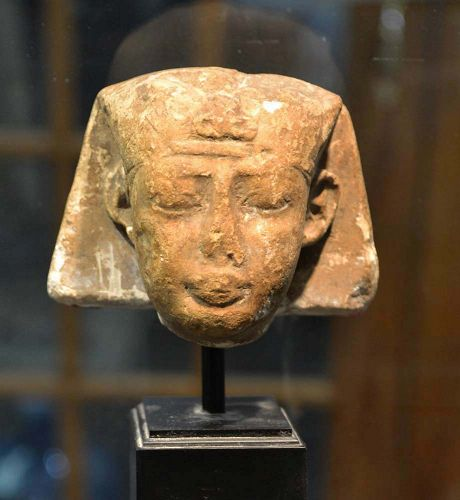 AN ANCIENT EGYPTIAN LIMESTONE HEAD OF A PHARAOH