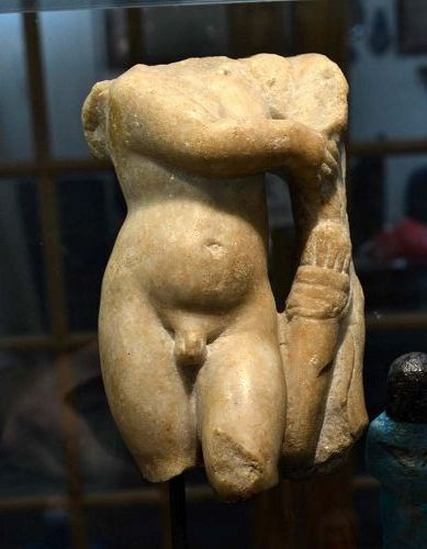AN ANCIENT ROMAN MARBLE OF EROS, EX. SOTHEBYS