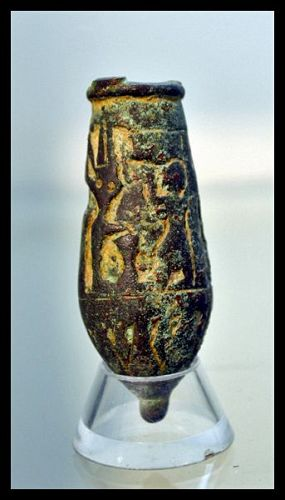 AN EGYPTIAN BRONZE SITULA WITH OFFERING SCENE