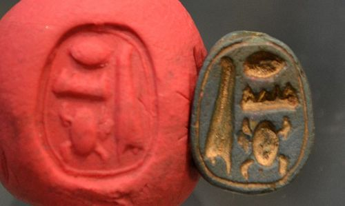 AN ANCIENT EGYPTIAN BLUE PASTE SCARAB