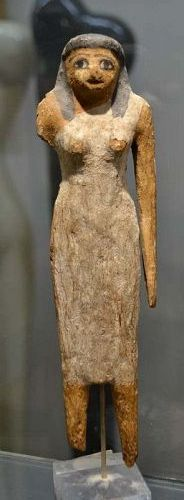 AN EGYPTIAN MIDDLE KINGDOM WOOD FEMALE FIGURE