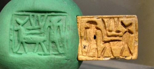 AN ANCIENT EGYPTIAN DOUBLE-SIDED STONE PLAQUE