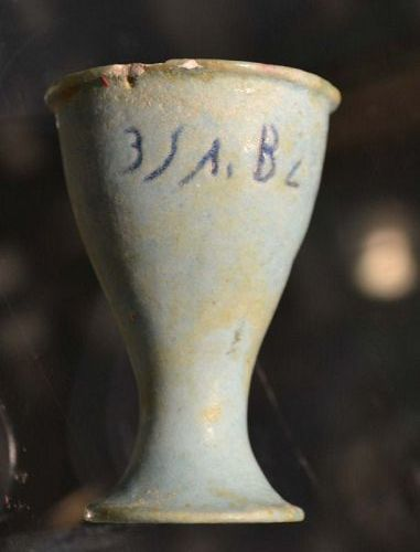 AN ANCIENT EGYPTIAN FAIENCE CUP