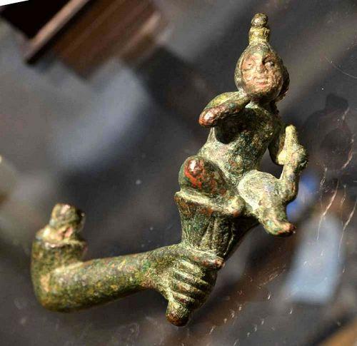 AN EGYPTO-ROMAN BRONZE HARPOCRATES