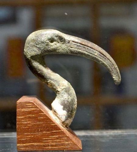 AN EGYPTIAN BRONZE IBIS HEAD