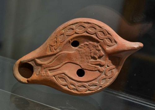 AN ANCIENT ROMAN RED-SLIP OIL LAMP