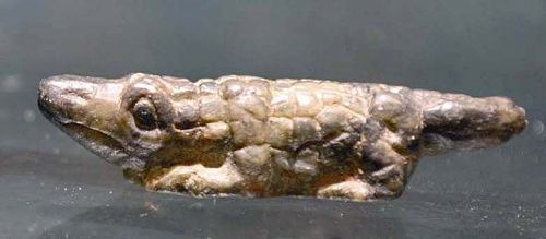 AN ANCIENT EGYPTIAN STONE CROCODILE