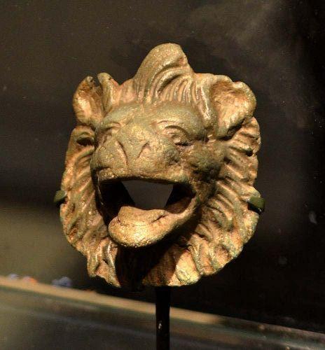 A ROMAN BRONZE HEAD OF A LION