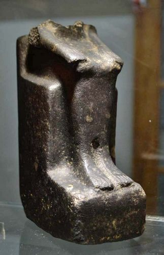 AN ANCIENT EGYPTIAN GRANO-DIORITE FIGURE OF A MAN