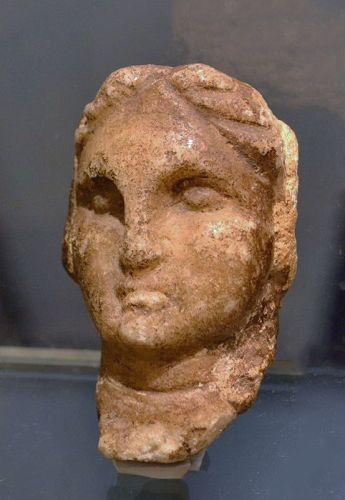 A GRECO-ROMAN MARBLE FEMALE HEAD