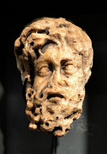 AN ANCIENT ROMAN MARBLE HEAD OF A MAN