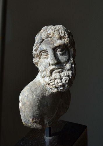 A ROMAN LIMESTONE BUST OF HERAKLES