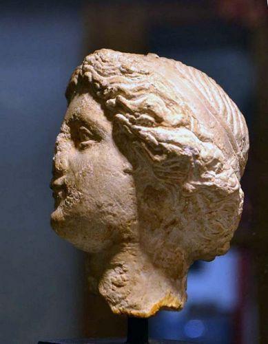 A GRECO-ROMAN LIMESTONE HEAD OF LADY