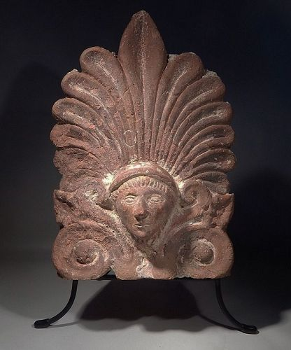 AN ANCIENT ROMAN TERRACOTTA SEA ENCRUSTED ANTEFIX