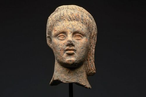 AN ETRUSCAN TERRACOTTA HEAD OF A YOUNG MALE
