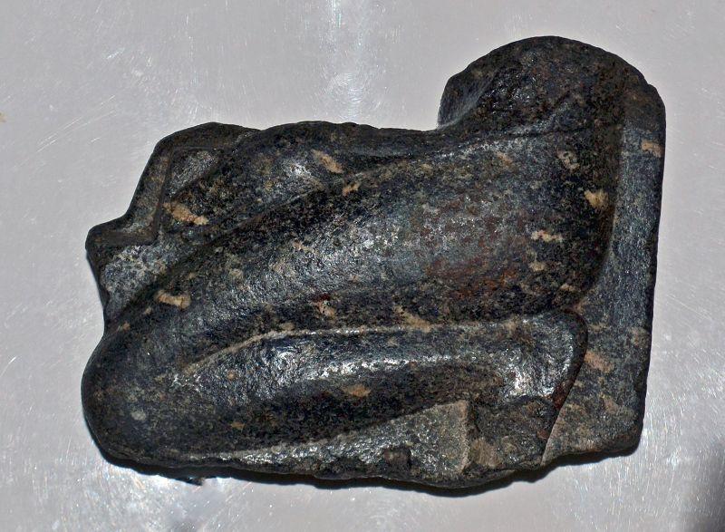AN EGYPTIAN BLACK GRANO-DIORITE KNEELING STATUE FRAGMENT