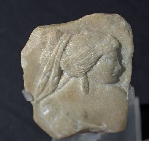 AN ANCIENT ROMAN MARBLE FRAGMENT