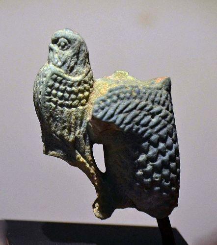 A FINE ANCIENT EGYPTIAN FAIENCE FALCON