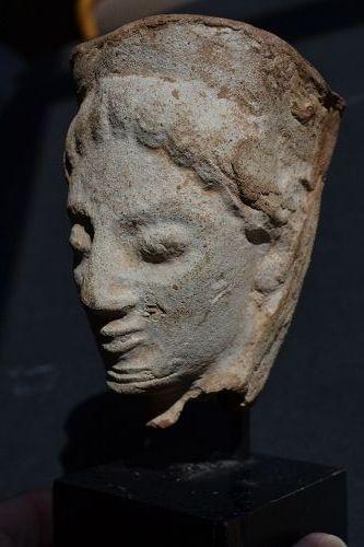 A GREEK TERRACOTTA FEMALE HEAD PROTOME