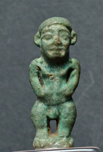 AN ANCIENT EGYPTIAN FAIENCE PATAICHOS AMULET