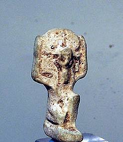 AN ANCIENT EGYPTIAN FAIENCE AMULET OF SHU