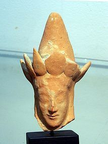 AN ANCIENT GREEK TERRACOTTA PROTOME OF A GODDESS