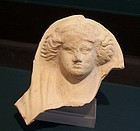 AN ANCIENT GREEK TERRACOTTA FIGURE OF A LADY