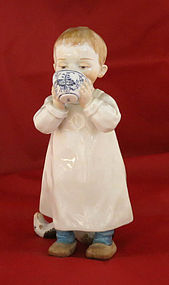 Meissen Figurine of Boy with Cup and Toy Horse