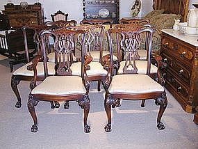 Eight Heavily Carved Mahogany Dining Room Chairs