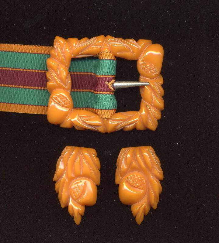 CARVED BAKELITE BELT BUCKLE AND CLIPS