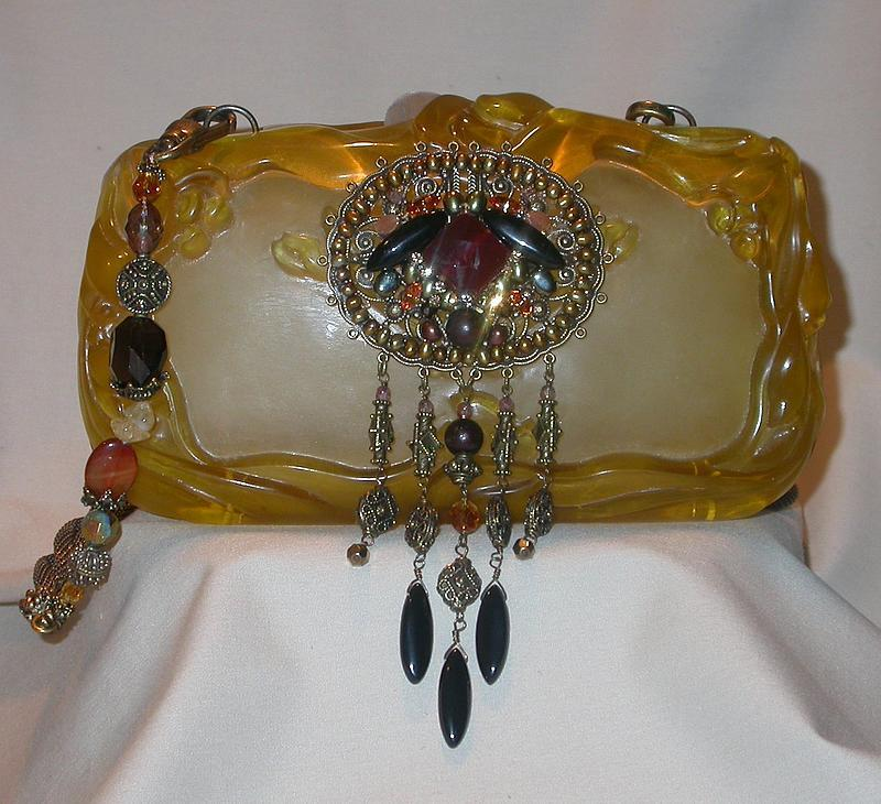 CARVED GOLDEN PURSE BY MAYA