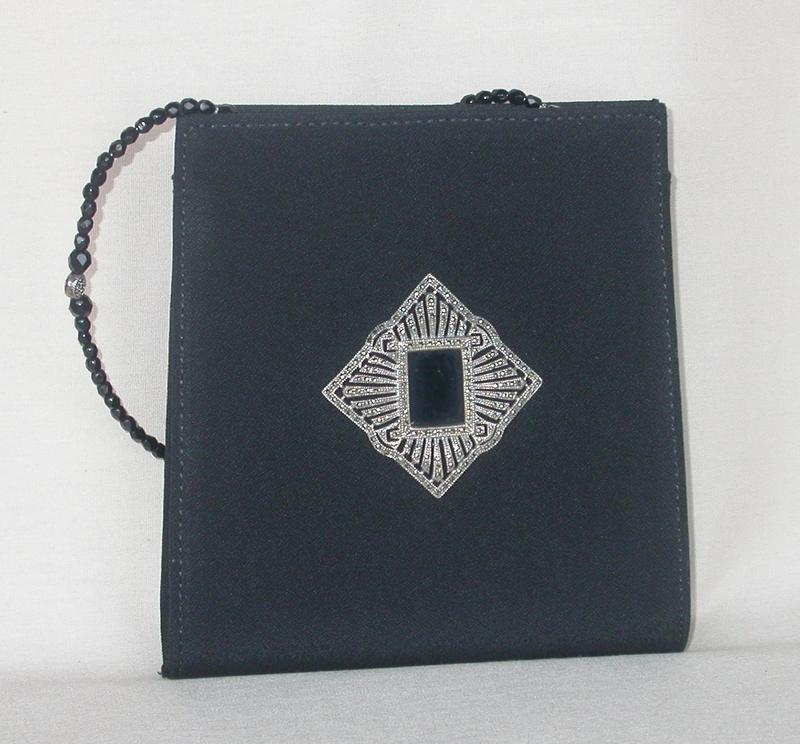 ELEGANT PURSE BY JUDITH JACK